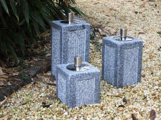 llampe aus granit mit edelstahlbeh lter der naturstein garten. Black Bedroom Furniture Sets. Home Design Ideas